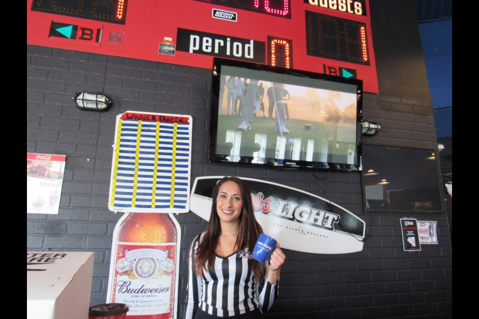 The Penalty Box server Miranda Franconeri coffee's up for another great day at The Penalty Box!