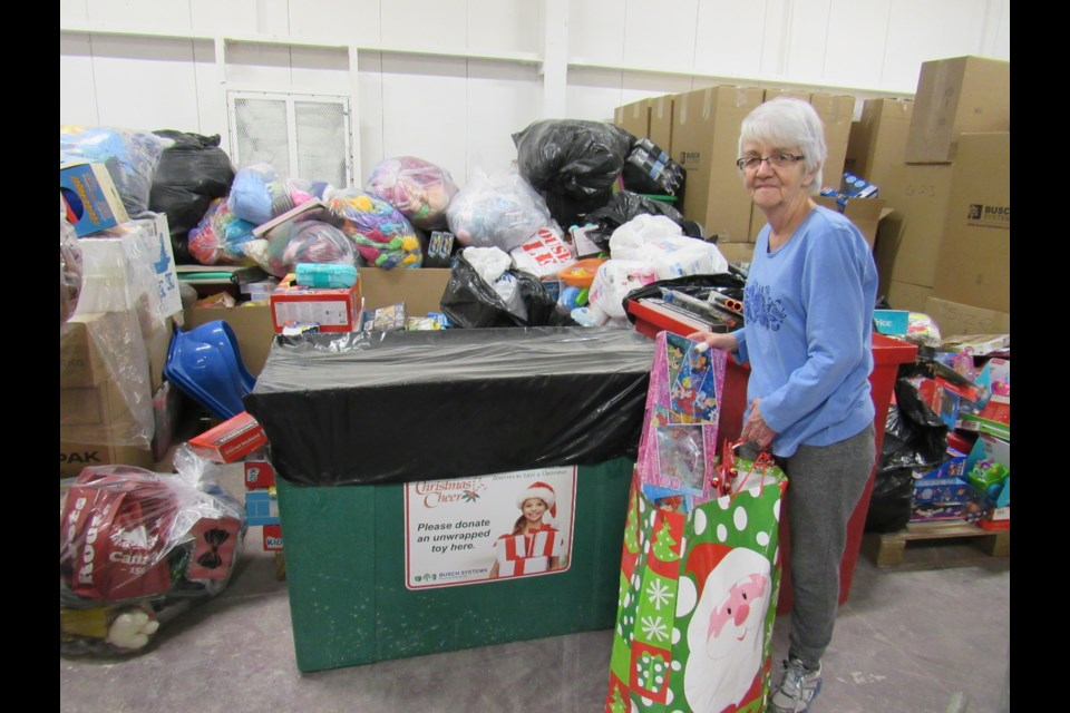 Valerie Blaker sorts toys received by Barrie and District Christmas Cheer. Shawn Gibson for BarrieToday