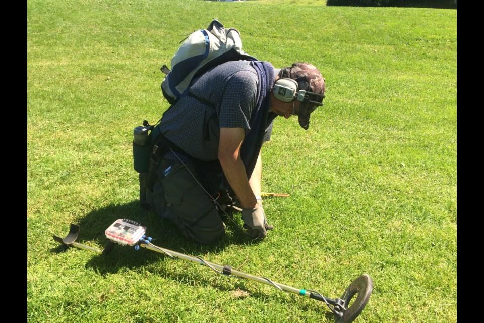 Mark McCallion digs where his  metal detector got a hit