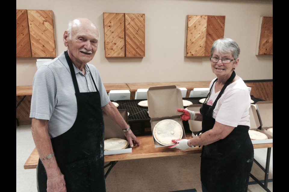Joe Girard and Lea Bale stand near some of the 264 meat pies baked in one day to help fundraise for the West Ferris Legion fundraiser