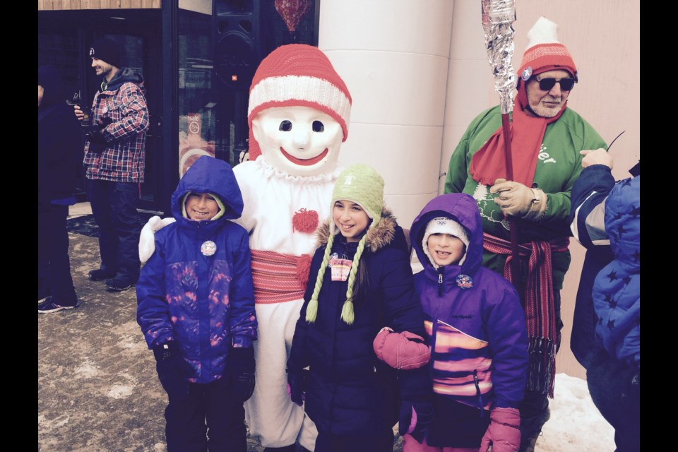 Bonhomme Carnaval poses with children in downtown North Bay