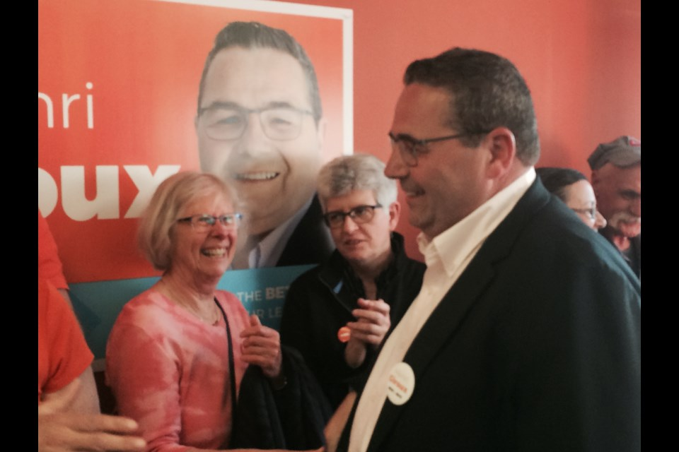 Ontario NDP candidate for Nipissing, Henri Giroux is greeted by supporters at the official opening of his campaign headquarters
