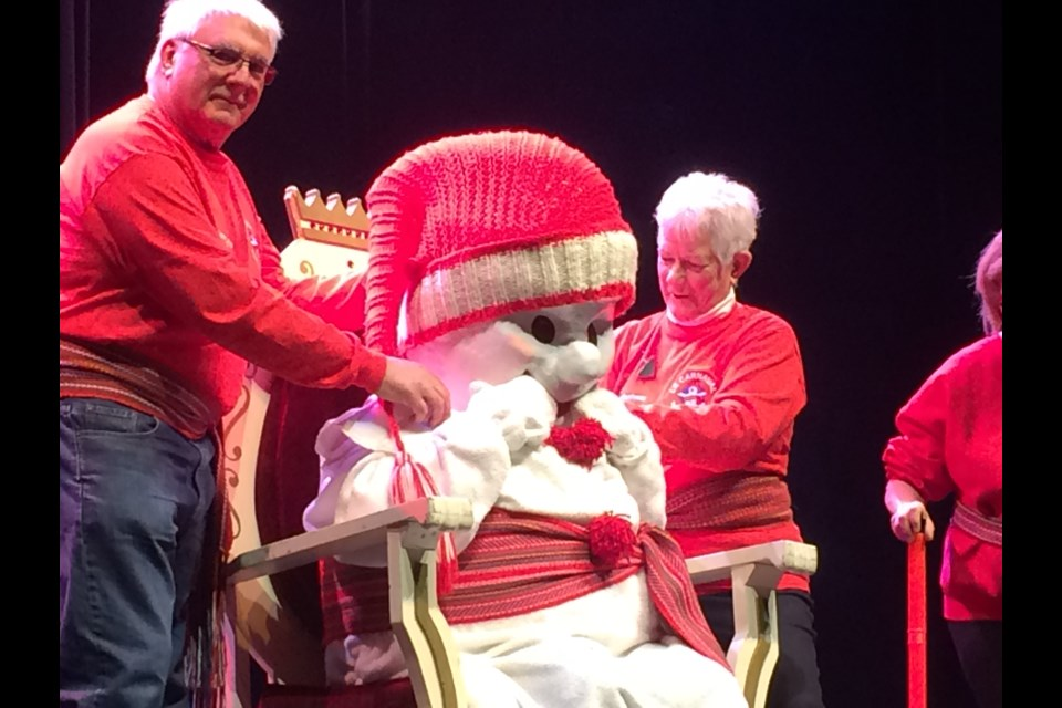 Le Bonhomme Carnaval is revealed at the closing ceremonies Sunday afternoon.