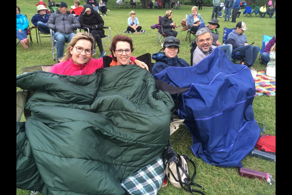(l-r) Deb Luckett, Lorraine Conway, Sarah Conway and Ralph Dellaquion stay warm to support the band Terrorbirds
