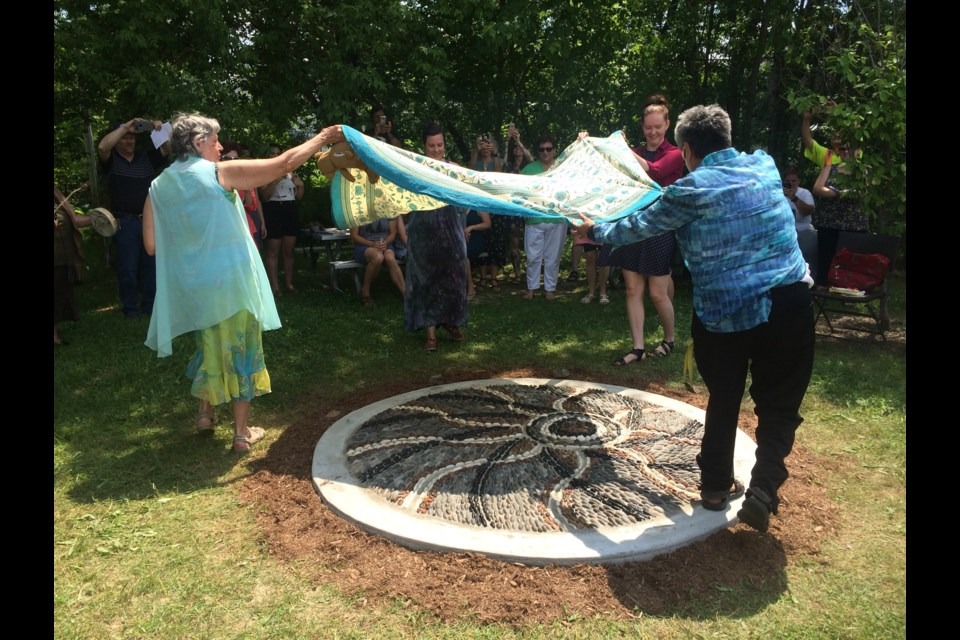Pebble mosaic honouring survivors of sexual violence unveiled