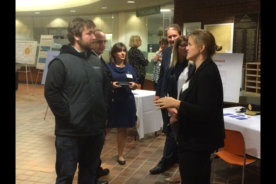 North Bay resident Bobby Ray listens to deputy mayor and budget chief Tanya Vrebosch at budget open house