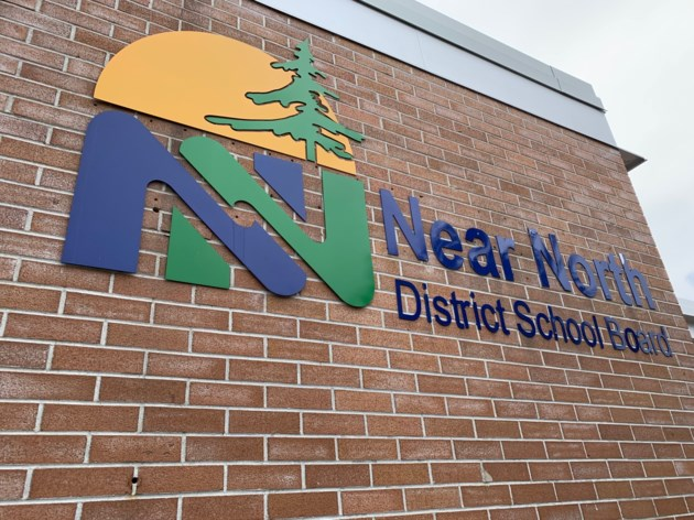 2019 0623 near north district school board logo on wall 1 turl