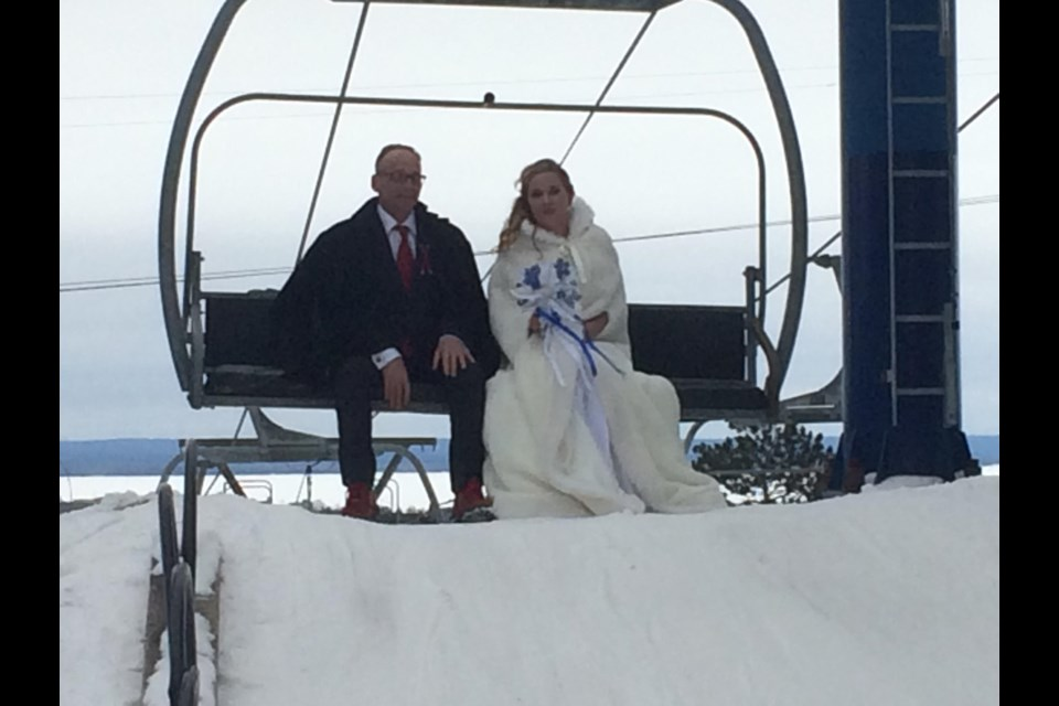Bride-to-be Kayla Whalen rides the chairlift with her father fulfilling her childhood dream