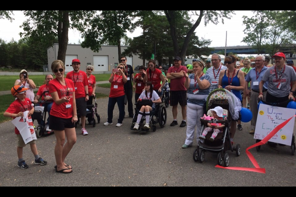 Meagan Wills cuts the ribbon to start the North Bay Walk for Muscular Dystrophy. Photo by Jeff turl.
