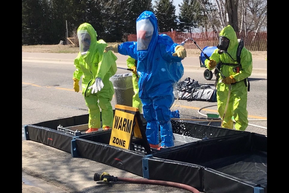 The North Bay firefighters entry team that isolated the chlorine leak consisted of Dave Tessier and Dan Catteau. They donned HazMat suits to contain a chlorine leak yesterday at the sewage plant. Courtesy North Bay Fire Department.