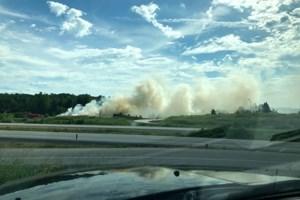Grass fire off Highway 11 near Powassan