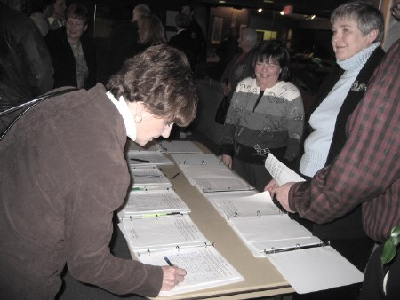 A petition presented to council Tuesday night by four former North Bay mayors is signed just outside the council chamber. Photo by Phil Novak, BayToday.ca</b>