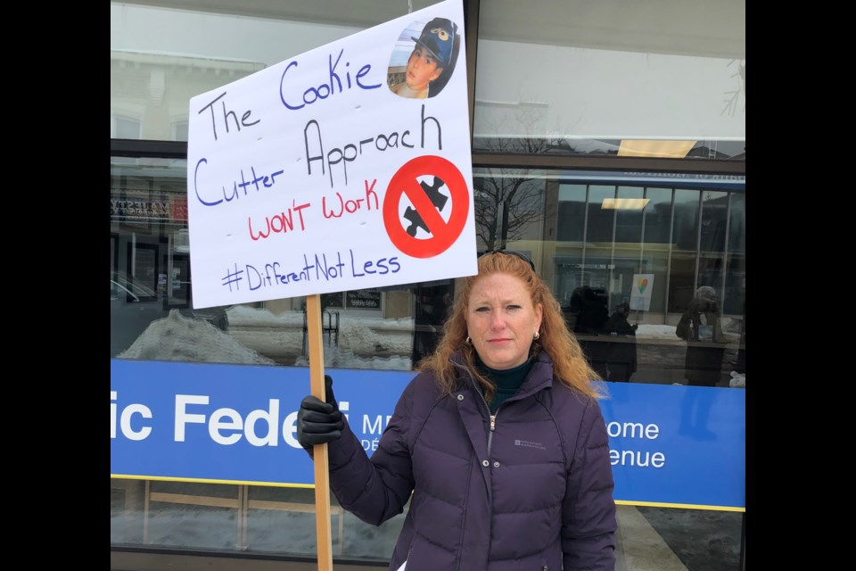 Kim Kelly-Cyr makes her views known at a prorest in front of Nipissing MPP Vic Fedeli's office. Bob Pipe/BayToday.