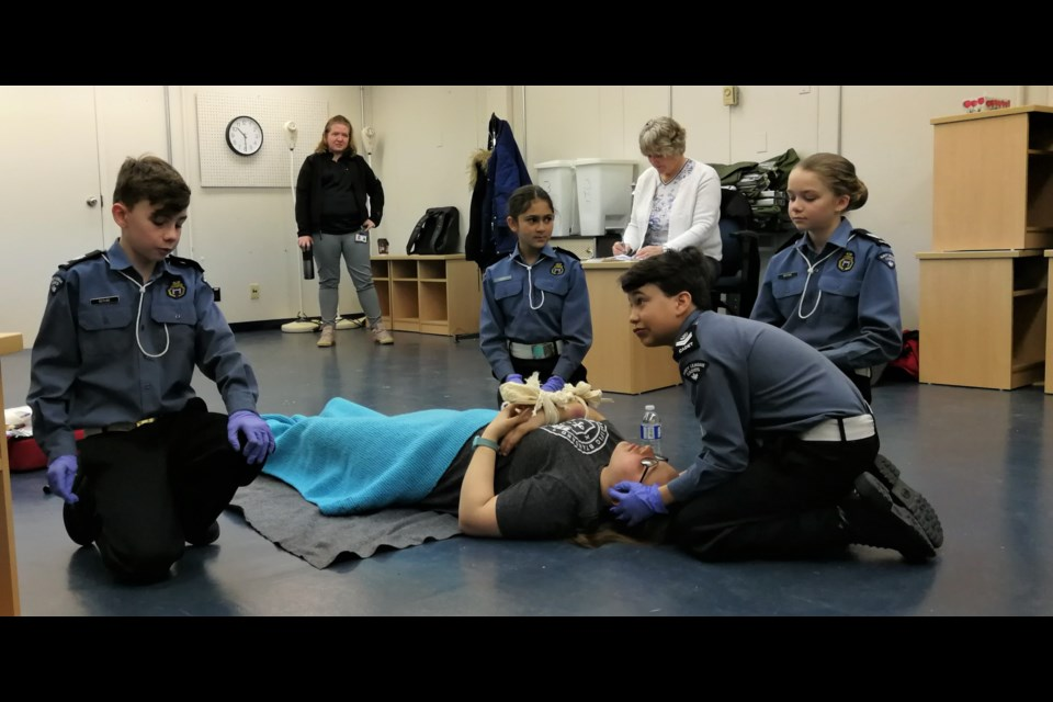 First Aid Team in action.  The scenario the cadets faced was a possible arm fracture, while their coach, Jennifer Proulx, and judge look on. Cadets on the bronze medal team are First Aid Captain Matthieu Berube and team members Isabelle Berube, Olivia Behe, Jakob Lacourse. Not pictured are Brooke and Hunter Doucette. Submitted.