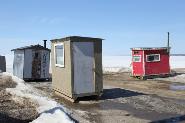 USED Ice huts waiting for removal at Amelia Park