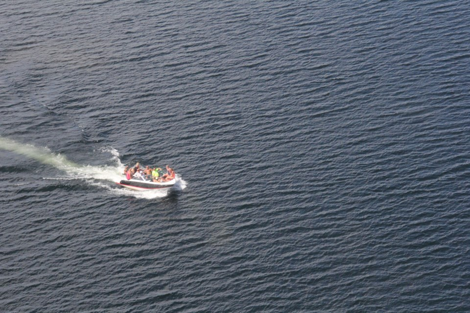 BAYSAR Search and Rescue plane surveys a vessel below for PFD use