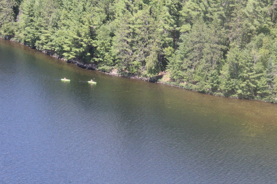Two kayakers visible from five hundred feet