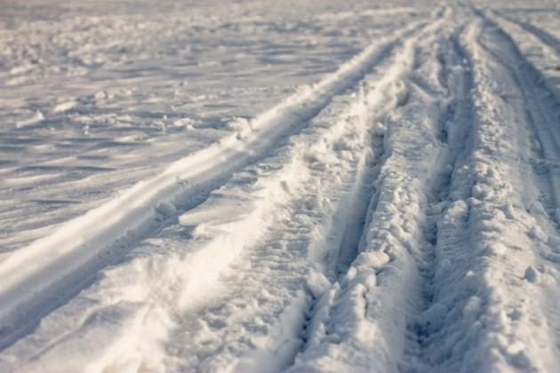 snowmobile tracks on ice AdobeStock_118521429 2016