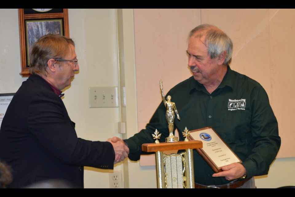 Gerry Geisler, 1st Vice of Zone D OFAH congratulates Paul-Emile Perron on his achievement, Supplied.