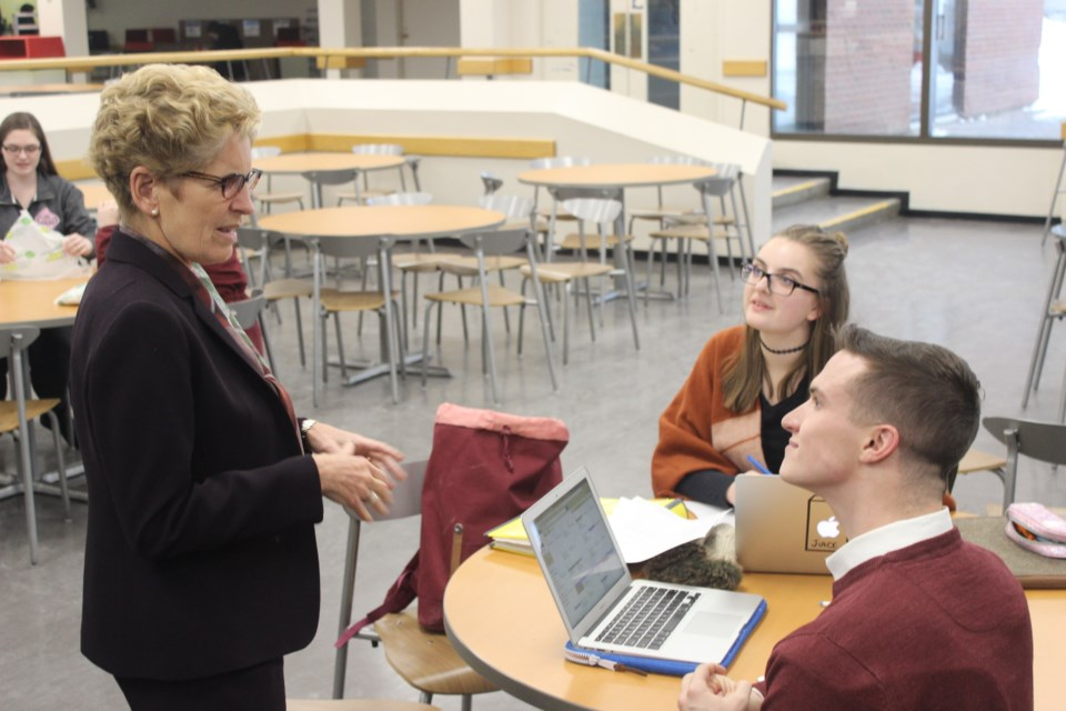 Premier Kathleen Wynne speaks with students during a tour of Canadore College. Photo by Ryen Veldhuis.