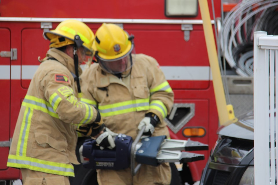 Firefighters use the jaws of life to free a vehicle from a hydro pole on Lakeshore Drive. Jeff Turl/BayToday.