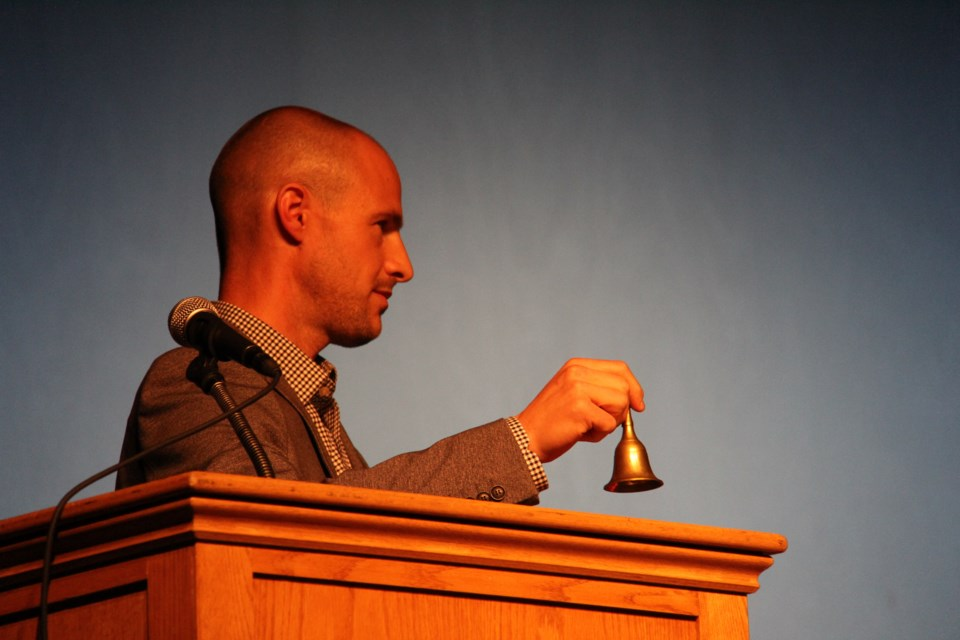 Teacher Mike Brisson rings a bell to tell one of the candidates that their time is up at an all candidates event at Chippewa this afternoon. Photos by Jeff Turl.