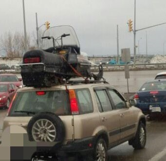 Definitely a dangerous way to transport your sled. Courtesy OPP.