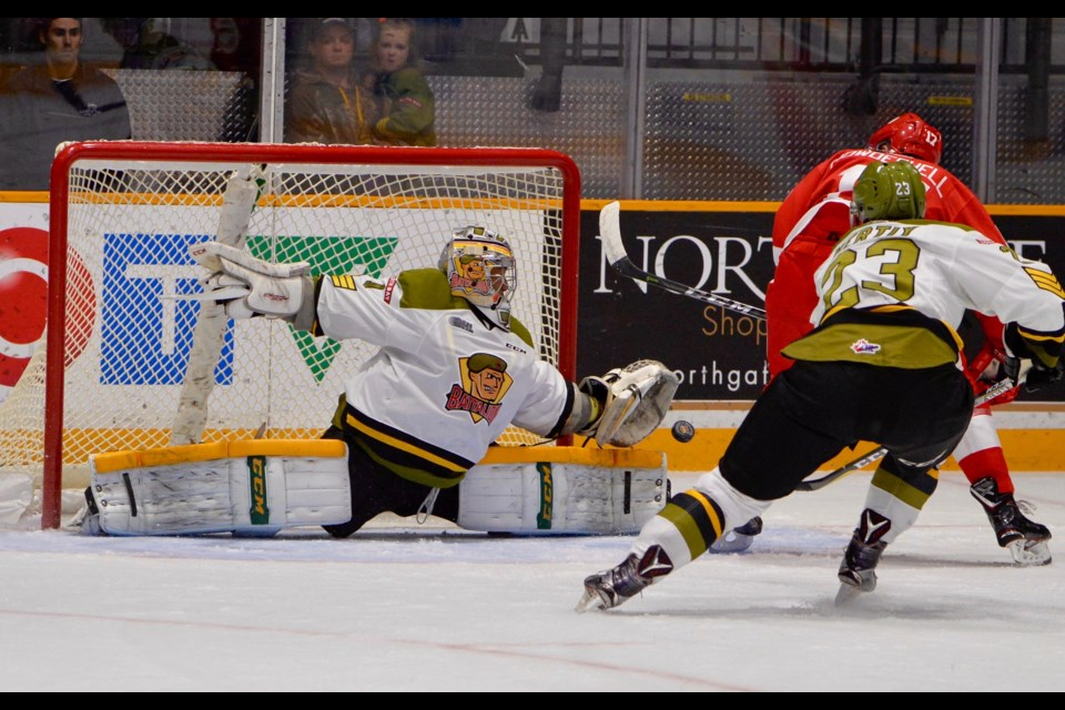 Soo Greyhounds forward Keeghan Howdeshell is stopped by North Bay Battalion goaltender Julian Sime in OHL action Friday night in North Bay. Tom Martineau for Village Media