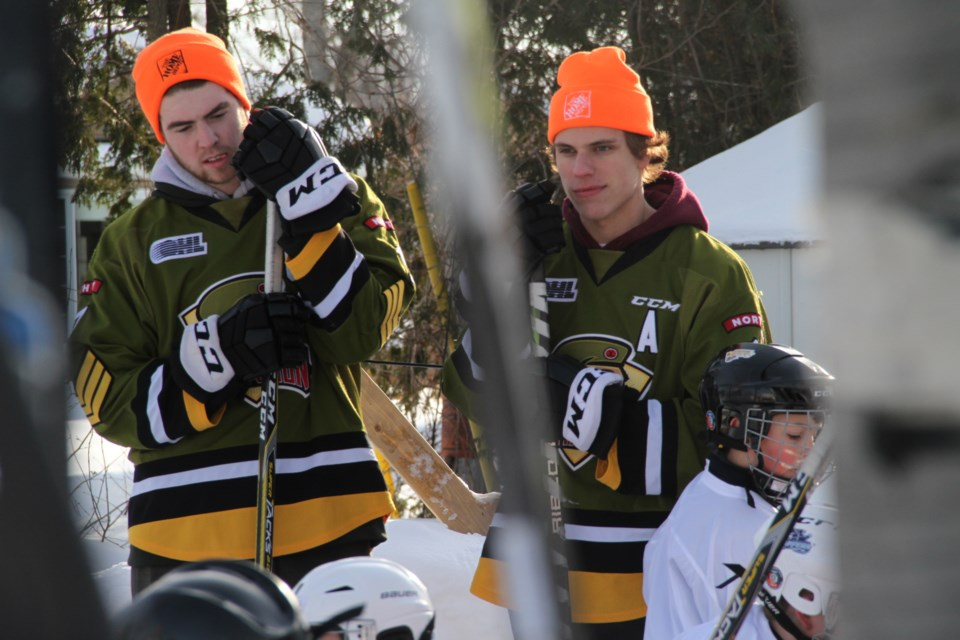 Linemates Justin Brazeau and Matt Struthers watch some ODR excitement.  Photo by Chris Dawson/BayToday.ca.