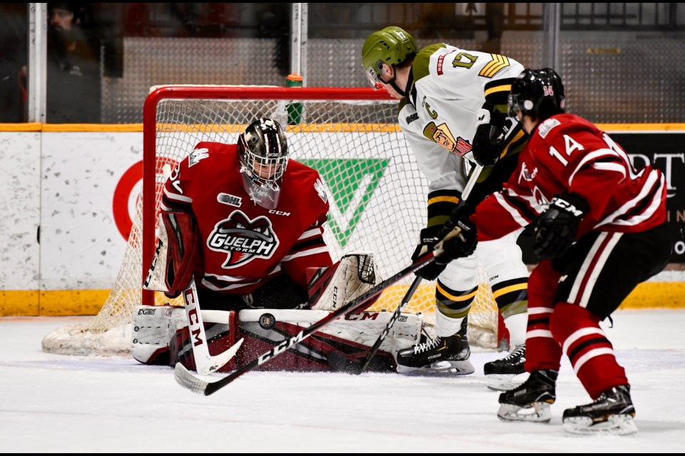 Guelph Storm goaltender Anthony Popovich makes a save on North Bay's Justin Brazeau in North Bay Sunday. Tom Martineau for BayToday.ca