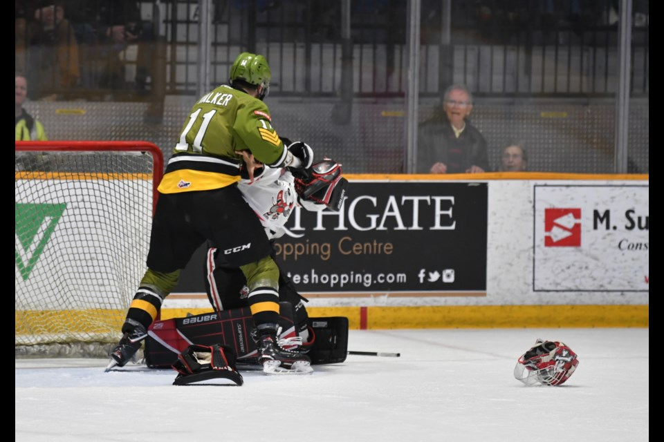 Daniel Walker and goalie Stephen Dhillon go toe to toe in the second period.  Photo by Tom Martineau/BayToday.ca.