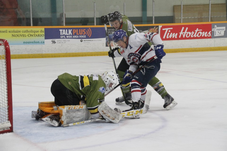 Battalion prospect Christian Cicigoi covers up a rebound during first period action.  Photo by Chris Dawson/BayToday.ca