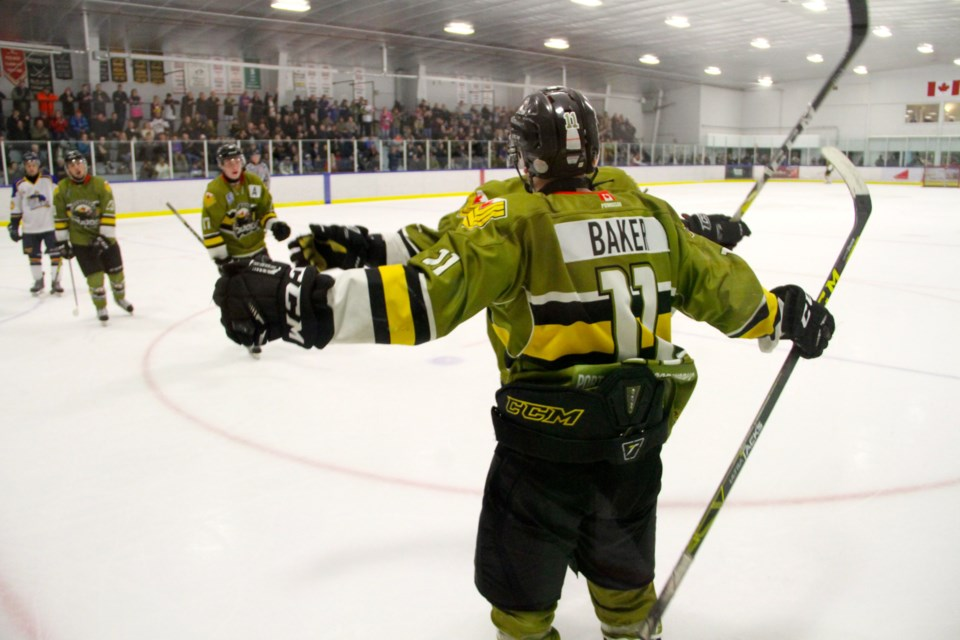 Andy Baker celebrates one of his two second period power play goals.  Photo by Chris Dawson.