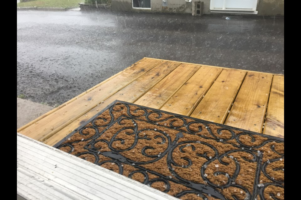 Hail stones the size of pebbles bouncing off this deck at a North Bay home on the north end of the city. Photo by Chris Dawson.