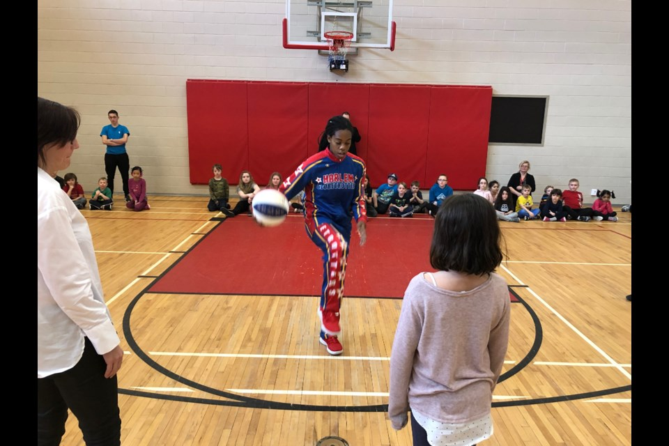 "Harlem Globetrotter Lili ""Champ"" Thompson teaches ball handling tricks at the North Bay YMCA in advance of the April 1 game."