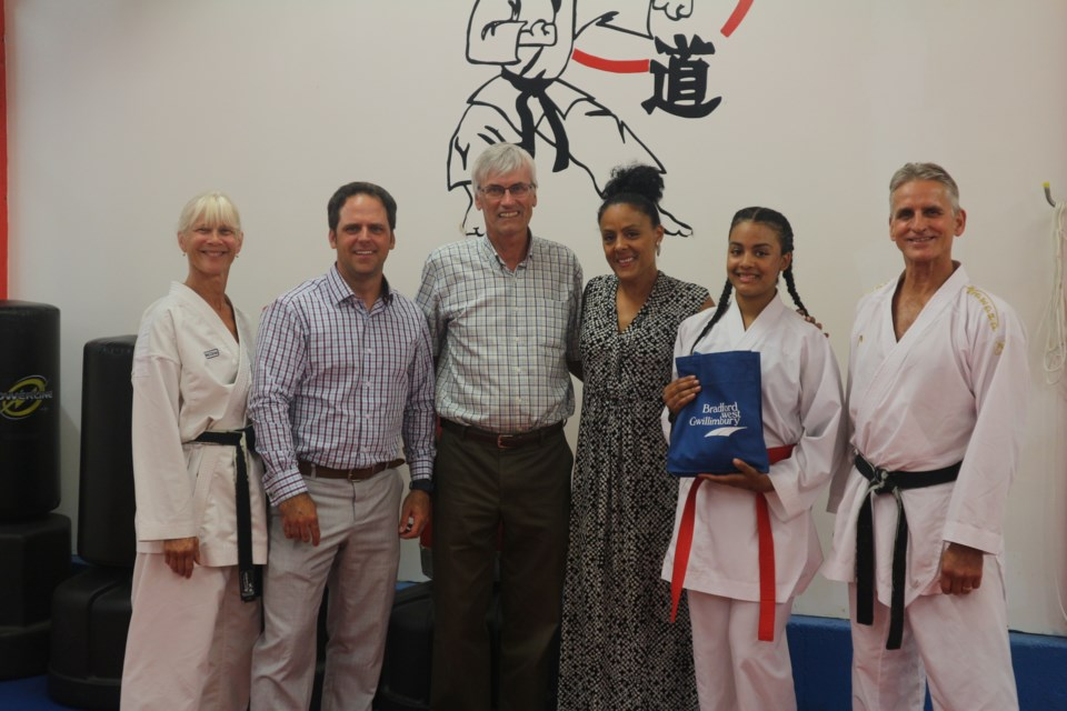 From Left to Right: Trish Jennings, Peter Ferragine, Rob Keffer, Ramona Deane, Olivia Deane and Jim Jennings at Jennings School of Karate to recognize Olivia's qualification to the Junior Pan American Games this month. Natasha Philpott/BradfordToday