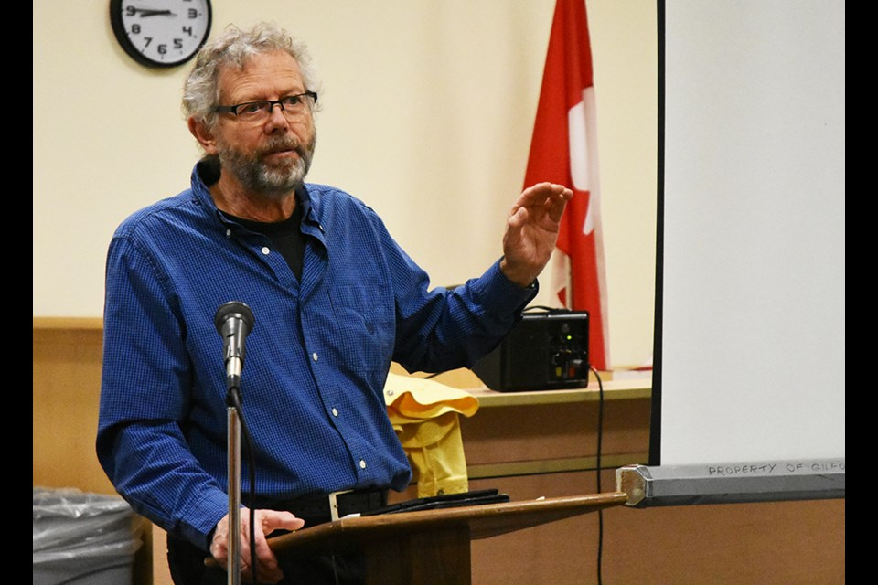 Dan Cooper, co-author of Gardening from a Hammock, talks about the 'low-maintenance garden' at a meeting of the Innisfil Garden Club. Miriam King/Bradford Today