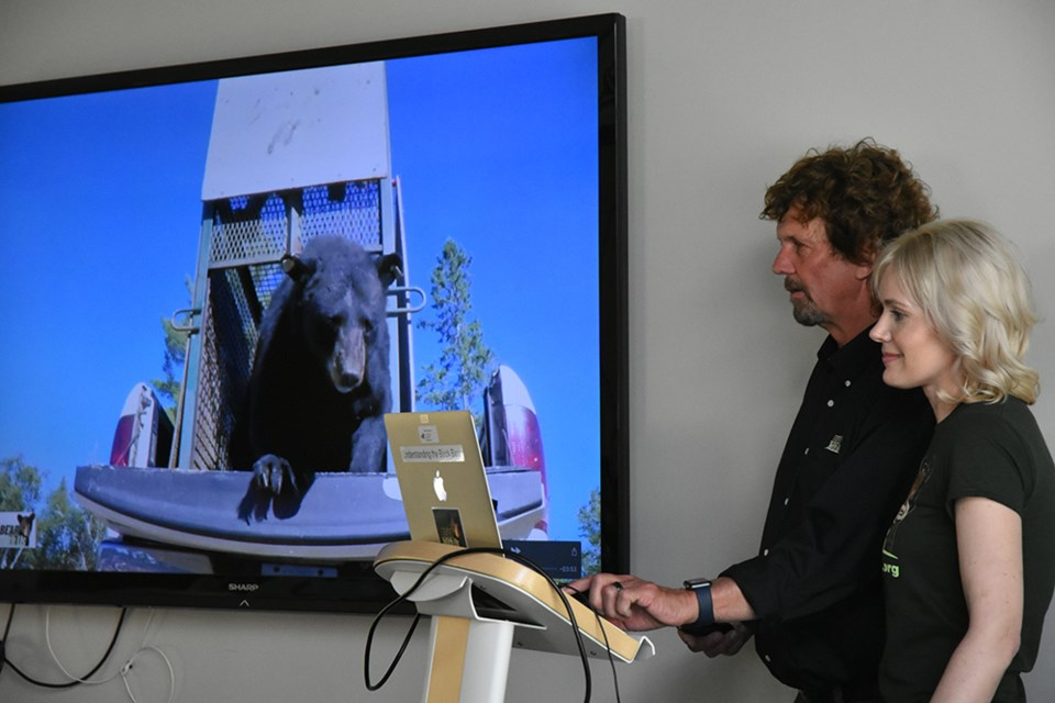 Mike and Ella McIntosh used slides and videos to talk about Ontario's Black bears, and the work of Bear With Us Sanctuary. Miriam King/Bradford Today