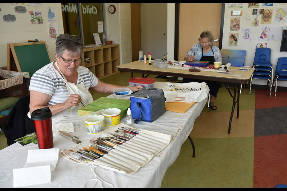 Stella Wadsworth, left, and Kathy Bury do their painting at the Creative Art Space on Thursday afternoons. Miriam King/BradfordToday