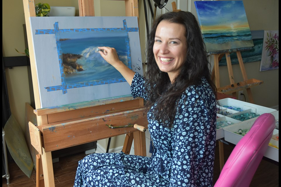 Maria Petrov works in pastels, in her home studio. Miriam King/Bradford Today