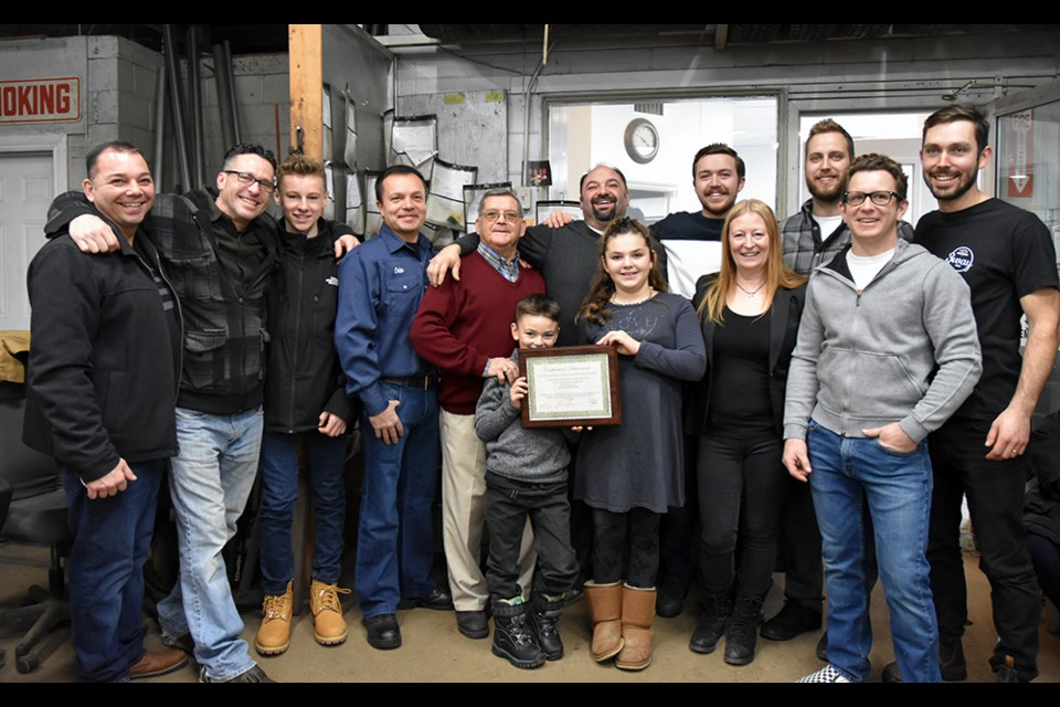 Vasco Duraes (centre) with daughter Addison, nine, son Cameron, six, and dad Dom, staff and, at left, brother George, at the 40th anniversary of D.D. Eagles & Sons Inc. Miriam King/BradfordToday