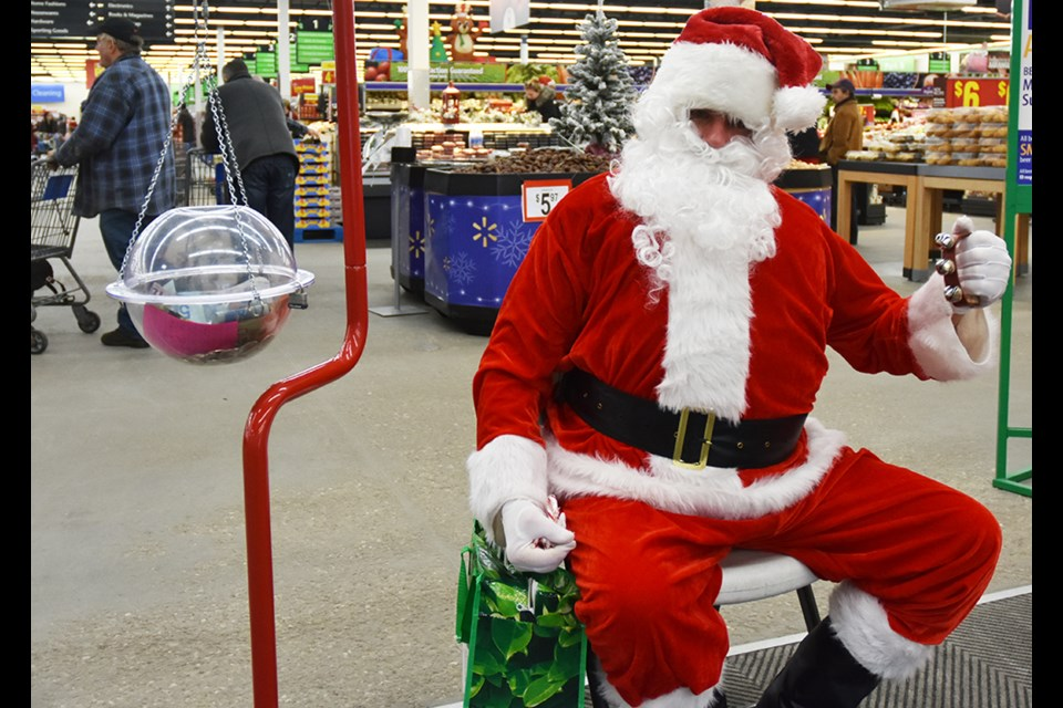Santa lends a hand, for the Salvation Army Christmas Kettle Campaign at Walmart in Bradford. Miriam King/BradfordToday