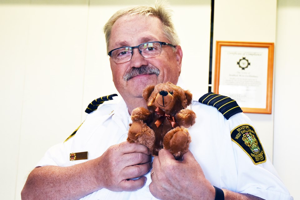 BWG Fire Chief Kevin Gallant with a stuffed bear. The fire department received a number of Quincy Project packages containing a stuffed animal, blanket and book to be handed out to children. Miriam King/Bradford Today