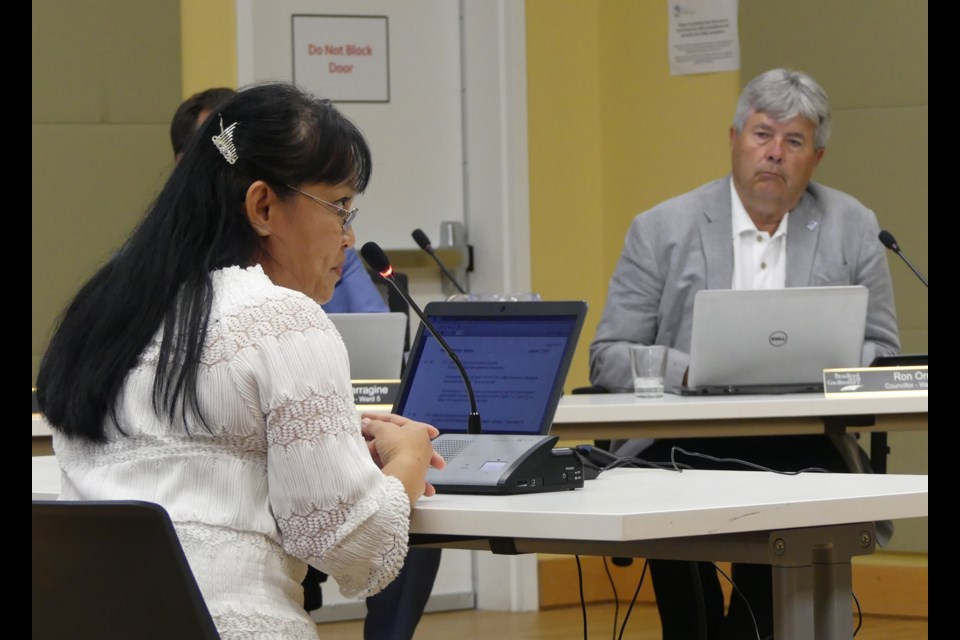 Punnapa Hartley, left, director of care at Bradford Valley Care Community, speaks to BWG council, as Coun. Ron Orr listens. Jenni Dunning/BradfordToday