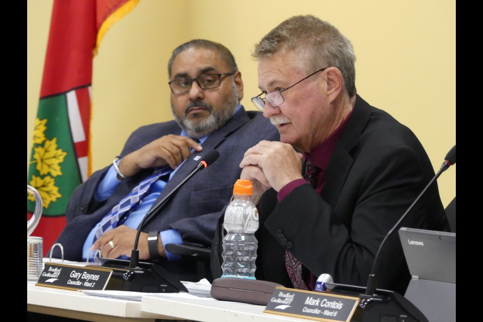 Councillors Raj Sandhu, left, and Gary Baynes during an April 2 council meeting.  Jenni Dunning/BradfordToday