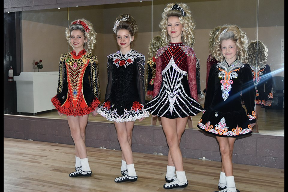Four dancers with the Miller School of Irish Dance - from left, Avery and Madalynn McGregor, Teagan Harrison and Teagan Mugford, in their competition dresses. 'It adds to your confidence, to have your own dress,' said Harrison. Miriam King/Bradford Today