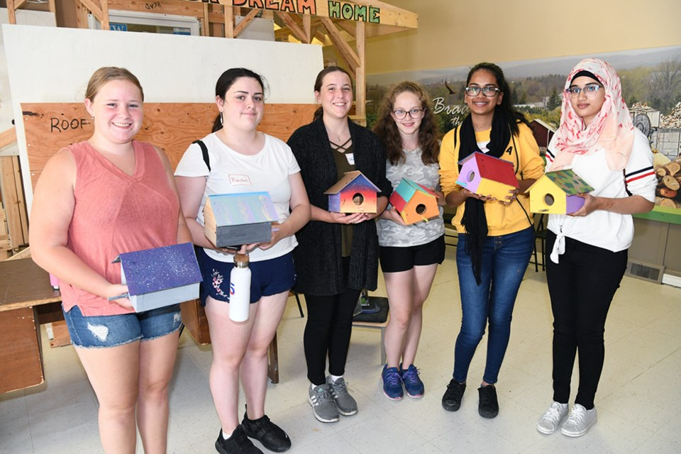 Learning principles of construction by making birdhouses, participants in the Youth Career Clarity Workshop with the finished products. Noor Din/Submitted photo
