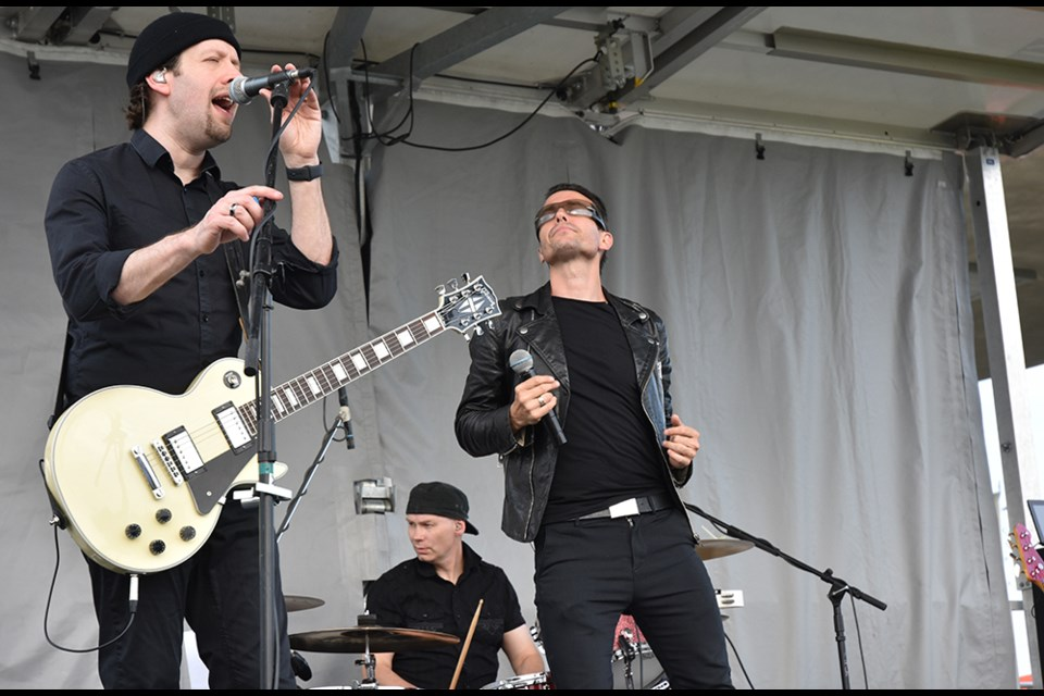 Elevation, Toronto-based U2 tribute band, on stage for Bradford's Music in the Park series. Miriam King/Bradford Today
