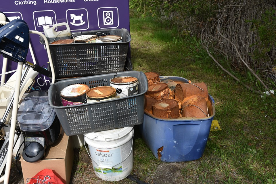 Contractor? Resident? Someone dropped old cans of paint - hazardous waste materials - outside a donation bin on Simcoe Road. Miriam King/Bradford Today