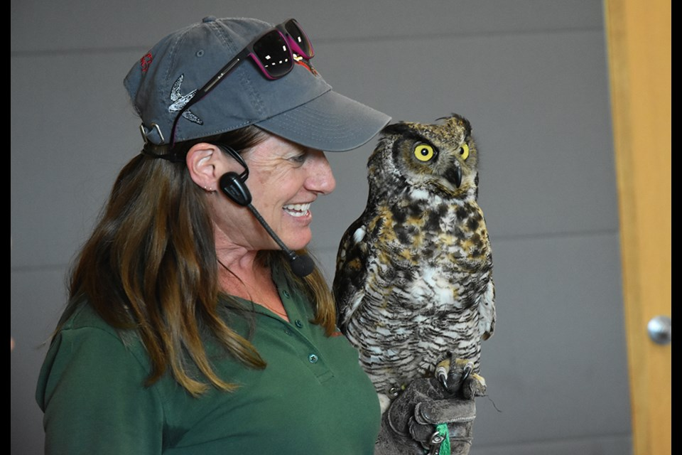 Shauna Cowan of the Canadian Raptor Conservancy, with a Great Horned Owl, at the library. Miriam King/Bradford Today